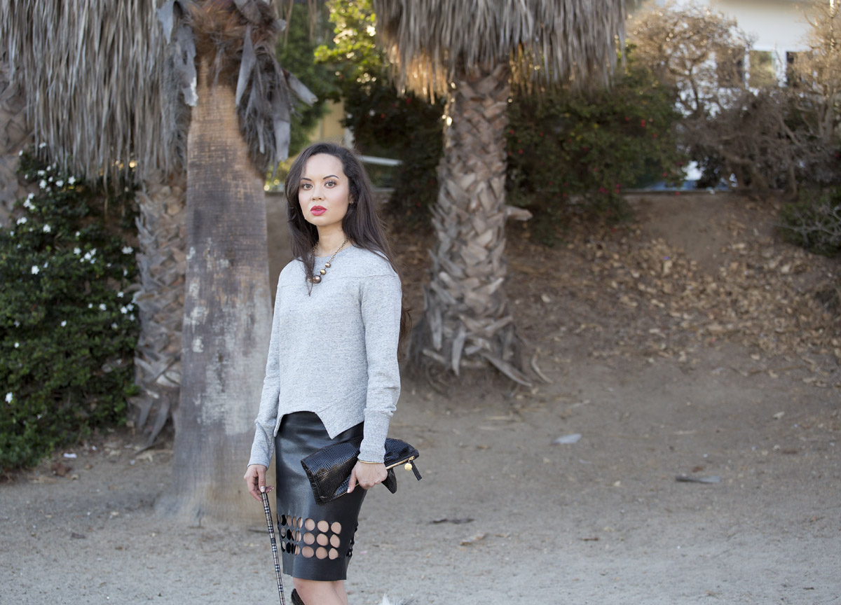 song of style, refinery29, who what wear, cut out leather skirt, papillon, los angeles fashion, shopping la, shopping los angeles, camille newbern, eurasian model, the la survival guide, la survival guide, helmut lang for uniqlo, urban sweat uniqlo, uniqlo sweatshirt, grey women's sweatshirt, black leather skirt, leather pencil skirt, kelly wearstler skirt, kelly wearstler clothing, kelly wearstler jewelry, kelly wearstler necklace, kelly wearstler cuff, kathryn amberleigh booties, blue booties, blue wedge booties, clare vivier clutch, black foldover clutch, j crew makeup