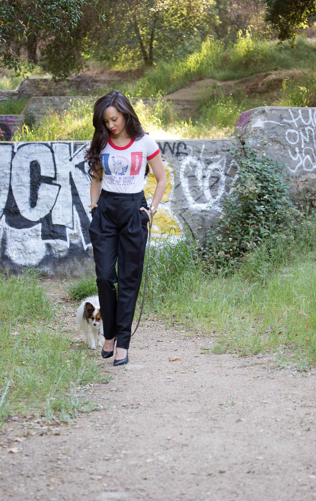 i have nothing to wear, graffiti, model graffiti, dog graffiti, model dog graffiti, photo shoot graffiti, griffith park graffiti, park graffiti, la graffiti, los angeles graffiti, vintage tee, vintage t-shirt, vintage shirt, vintage womens tee, vintage womens t-shirt, vintage new york tee, vintage new york t-shirt, vintage ny tee, vintage ny t-shirt, band of outsiders black womens pants, band of outsiders black womens trousers, black womens trousers, black womens pants, black womens slacks, iro heels, iro pumps, iro black heels, iro black pumps, black leather heels, black leather pumps, draped black pants, michele lobosco, photographer michele lobosco, la photo shoot, los angeles photo shoot, model on dog walk, dog and model, off duty model style, la style, los angeles style, model eyelashes, model street style, gold bodychain, gold body chain, body chain, bodychain, street style, la street style, ootd, ootn, model lips, perfect lips, camille newbern, the la survival guide, la survival guide, thelasurvivalguide, lasurvivalguide, los angeles fashion blogs, los angeles style blogs, drybar, drybar model, drybar blowout, long hair blowout, blushington, blushington weho, blushington makeup, papillon, papillon dog, eurasian models, eurasian actresses, shopping los angeles, shopping la, modeling la, modeling los angeles, jouer grace, xiv karats, xiv karats necklace, xiv karats diamond necklace, catbird rings, artelier world cuff, map cuff, griffith park photo shoot