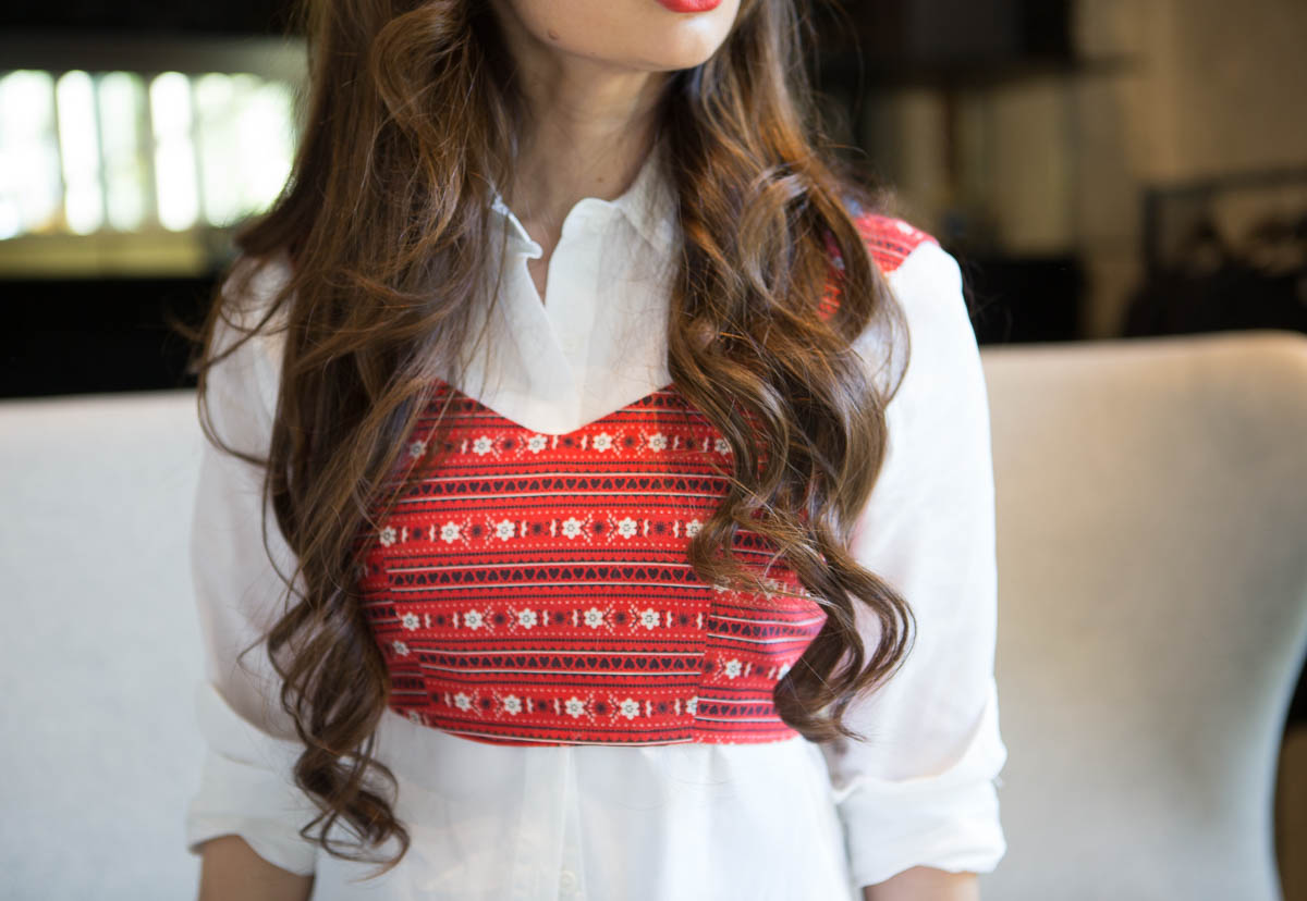Camille of the LA Survival Guide wearing printed top over white blouse